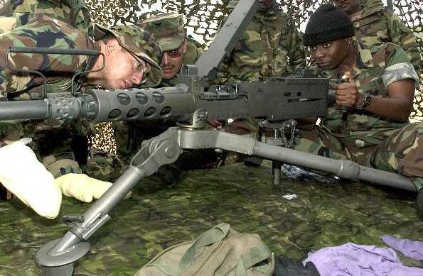 صور لمحبي الاسلحة WNUS_50cal-M2_MG_Tripod_pic.jpg